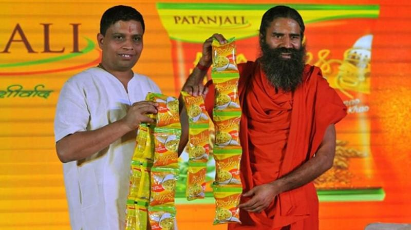 Acharya Balkrishna, the head of yoga expert Baba Ramdev-run FMCG company Patanjali has made it to Hurun's list of richest Indians. Photo: PTI