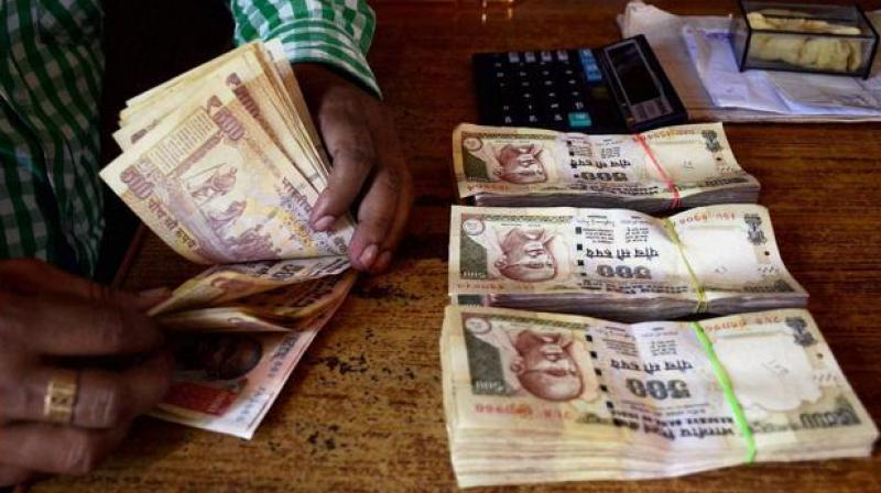 "The Income Tax Department will soon issue notices to those who have deposited ""suspicious"" amounts of money in banks post-demonetisation and have not responded to taxman's preliminary communication. (Photo: PTI)"