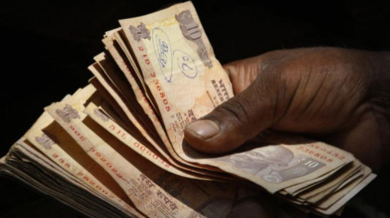 A weak dollar in global markets helped the rupee limit its losses. (Photo: AP)