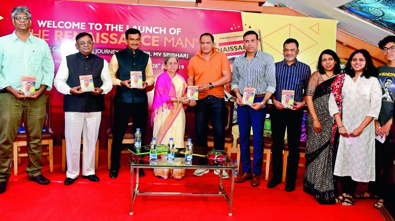 Late M. V. Sridhar's mother Dr Pushpa (centre), wife Sagarika, daughter Anindita, son Arnav (right) pose with former cricketers Md Azharuddin, VVS Laxman, Venkatapathi Raju, author Harimohan Paruvu (left), former HCA president G. Vinod (second from left) and CISF IG C. V. Anand (third from left) after the release of The Renaissance Man.
