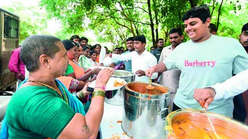 TRS working president K.T. Rama Rao's son Himanshu serves food to people near Basavarama Tarakam Cancer Hospital in the city on Wednesday.