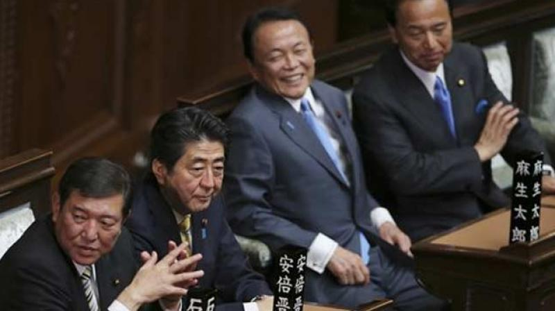 File photo of Japanese PM Shinzo Abe, second left, Regional Issues Minister Shigeru Ishiba, left, and Finance Minister Taro Aso, third left. (Photo: AP)