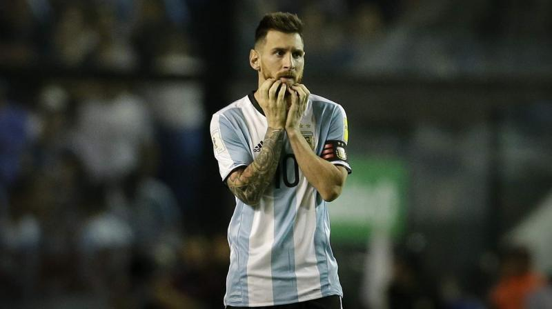 Lionel Messi has identified Spain as the one country he hopes to avoid in the group stages of the World Cup finals next year. (Photo: AP)