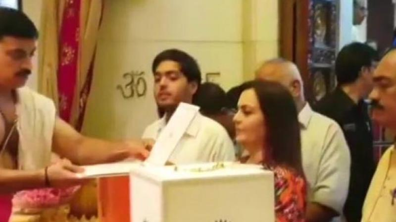 Nita Ambani presents Akash Ambani, Shloka Mehta's engagement invite