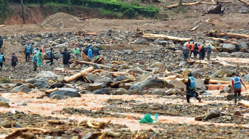 Rescue workers at Puthumala where a landslide on Thursday washed away a town