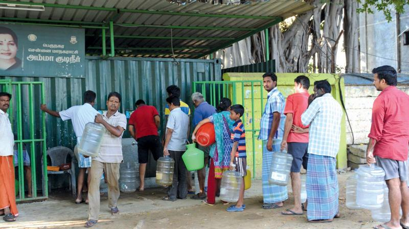 People wait near Chennai Corporation Amma drinking water centre at Moggapair on Wednesday as drinking water lorries and private suppliers went on strike. (Photo: DC)