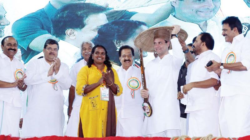 AICC president Rahul Gandhi before presenting an oar to Rekha Karthikeyan who became the first woman in the country to obtain deep-sea fishing licence at the at the National Fishermen's Parliament at Thripparayar on Thursday. V.D. Satheesan, MLA, AICC general secretaries Mukul Wasnik and Oommen Chandy, leader of opposition Ramesh Chennithala, National Fishermen Congress chairman and Thrissur DCC president T.N. Prathapan and AICC general secreatry  K.C. Venugopal are also seen.  (ANUP K. VENU)