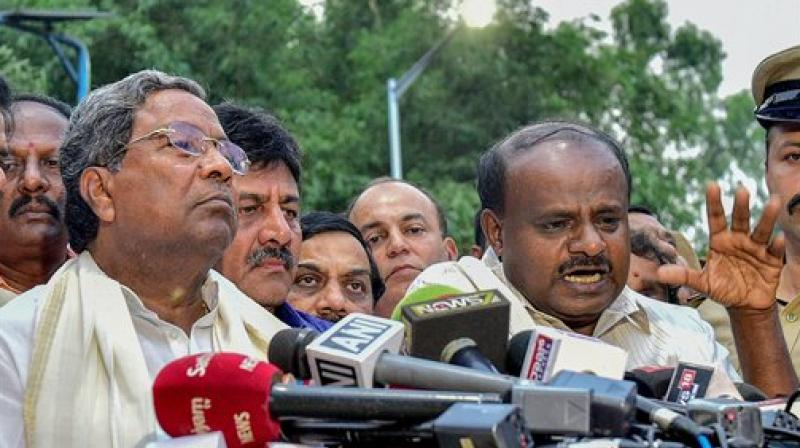 Outgoing Karnataka Chief Minister Siddaramaiah and JD(S) President HD Kumaraswamy address the media after a meeting with Governor Rudabhai Vala in relation with in Bengaluru on Tuesday. (Photo: PTI)