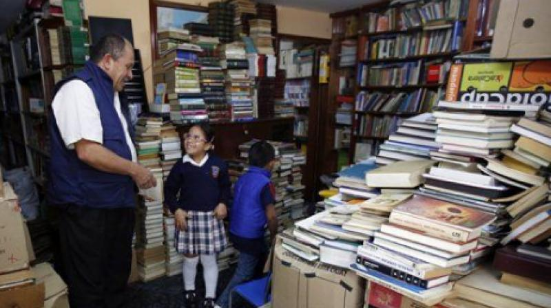 The Cambodian has an in-house library that has all the books he has collected over the years from richer areas in Southern Bagota. (Photo: AP)