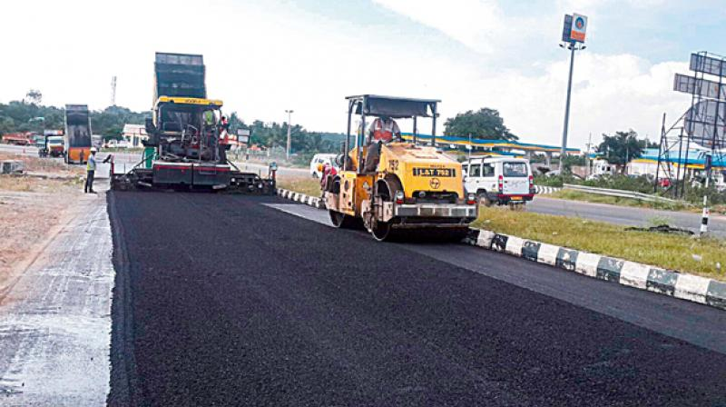 laying of polymer coated bitumen roads in B5 – transport, laying & compaction  coated macadam (asphalt concrete) for roads and other paved areas  be coated with hot bitumen.
