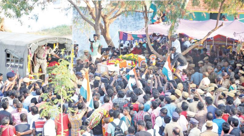 People participate in the funeral procession of CRPF jawan Subramanian at Savalaperi village in Thoothukudi on Saturday evening.—DC