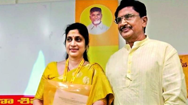 Roopa Maganti with Maganti Murali Mohan.