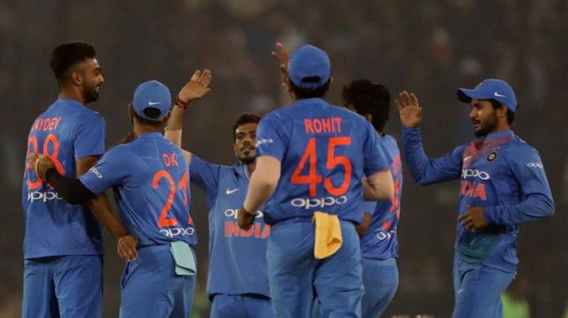 Sharma hits record-equalling T20 ton in India win