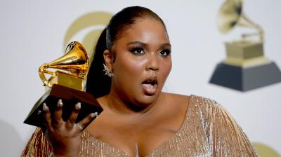 American singer-songwriter Lizzo poses with her awards for Best Pop Solo Performance, Best Urban Contemporary Album and Best Traditional R& B Performance during the 62nd Annual Grammy Awards on January 26, 2020, in Los Angeles. (AFP)
