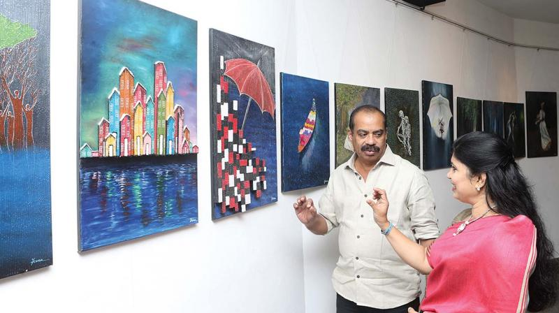 Jeena with director Sathyan Anthikad at the gallery