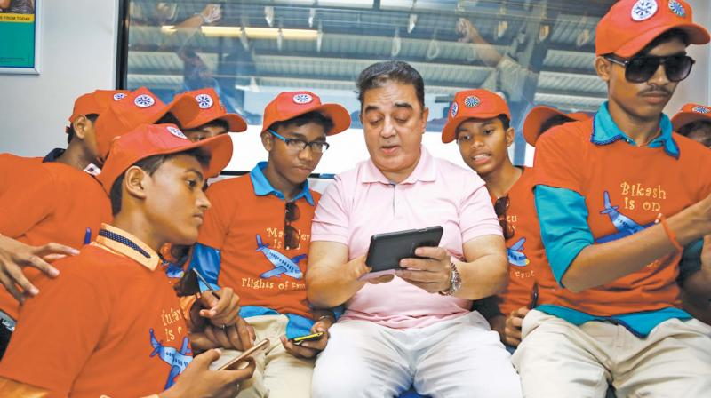 Kamal Haasan interacts with children during a metro ride in the city. (Photo: DC)