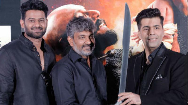 Prabhas, Rajamouli and Karan Johar at the trailer launch of 'Baahubali: The Conclusion.'