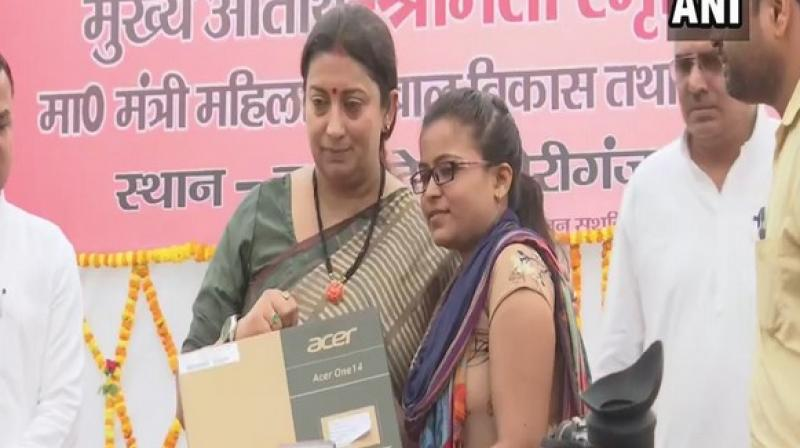 Irani was attending an event for the mass baby shower and 'Annaprashana' in Amethi's Gauriganj, where she distributed laptops to 240 Lekhpals. (Photo: ANI)