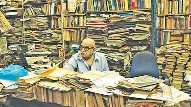 Govindaraju in his bookstore with his collection of books.