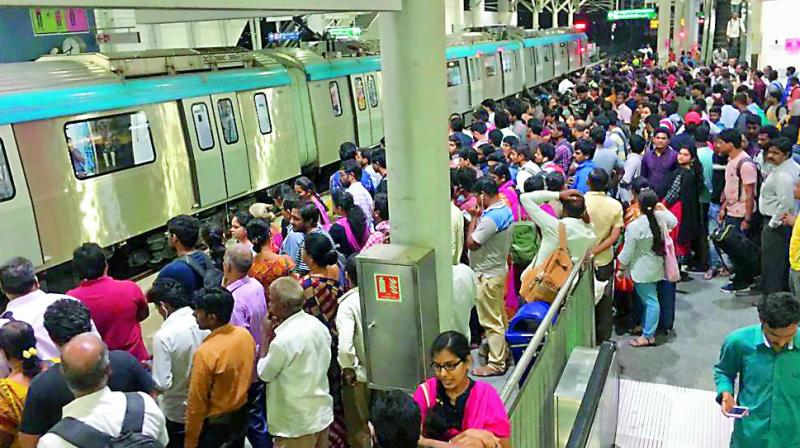 Hundreds of people opted for Metro Rail to commute in the city on Saturday in the wake of an indefinite strike by RTC employees on Saturday. (Photo: S. Surender Reddy)