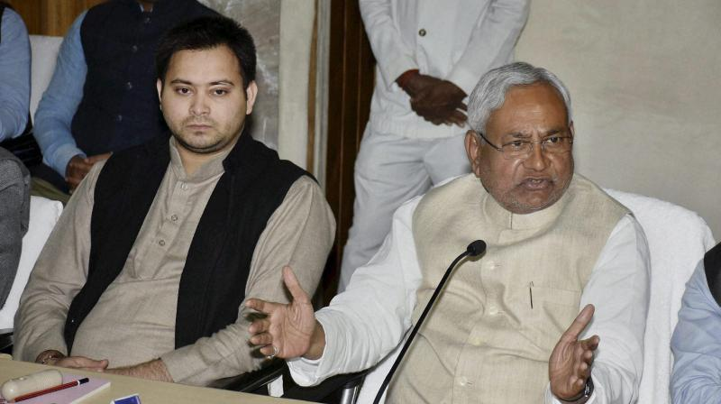 Bihar CM Nitish Kumar addresses a press conference along with deputy CM Tejaswi Yadav at the Secretariat, in Patna. (Photo: PTI)
