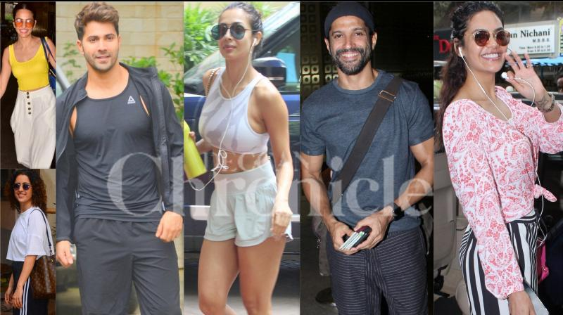 Bollywood celebrities like Varun Dhawan, Malaika Arora, Farhan Akhtar, Sanya Malhotra, Esha Gupta, Kirti Kharbanda, Angad Bedi and others were snapped in the city of dreams, Mumbai. (Photos: Viral Bhayani)