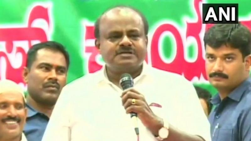'We don't need any coalition now. I don't need power, I need your love,' Kumaraswamy said while addressing a meeting of party workers. (Photo: ANI)