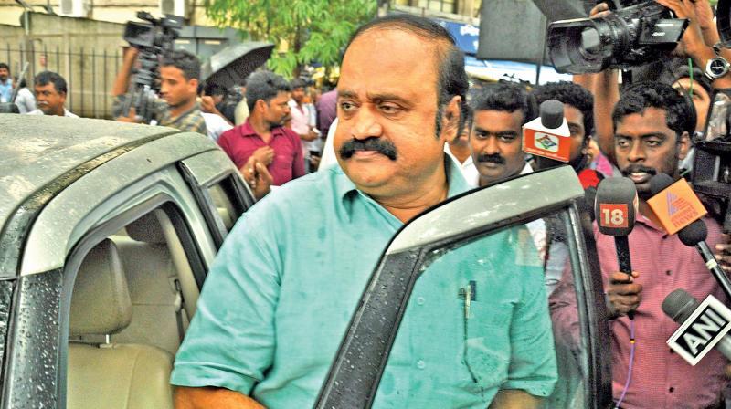 V. Pugazhendi, a loyalist of TTV Dhinakaran and the Karnataka state secretary of AIADMK, appears before the I-T department on Monday responding to their  summons. (Photo: DC)