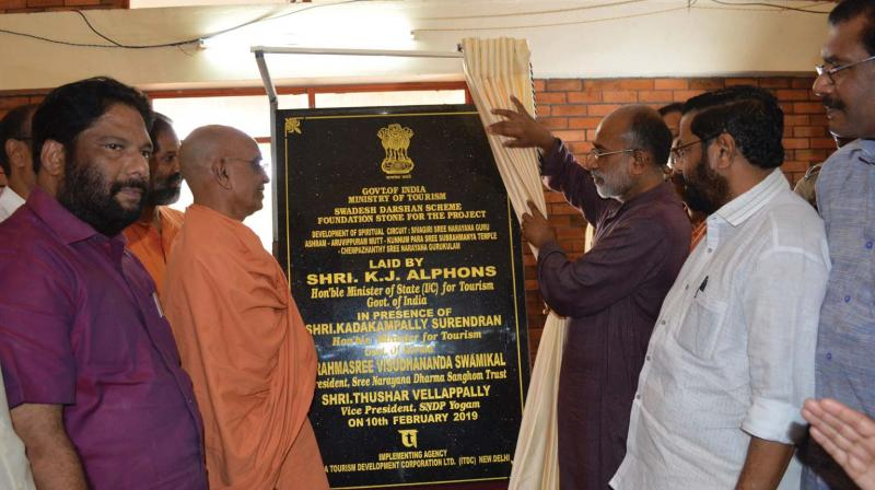 Union minister of state for tourism K. J. Alphons unveils the plaque of the Sivagiri Pilgrimage Circuit at Sivagiri Mutt in Varkala on Sunday. Also seen are state tourism minister Kadakampally Surendran, A. Sampath,MP, V. Joy,MLA and  Sree Narayana Dharma Sangham Trust president Swami Vishudhananda.