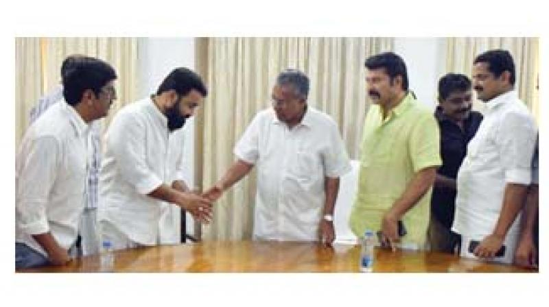 Actor Mohanlal greets Chief Minister Pinarayi Vijayan during a meeting with cinema industry representatives in Kochi on Sunday. Also seen are FEFKA general secretary B. UnniKrishnan, actor Mammootty, producers Antony Perumbavoor and Anto Joseph. (Image DC)
