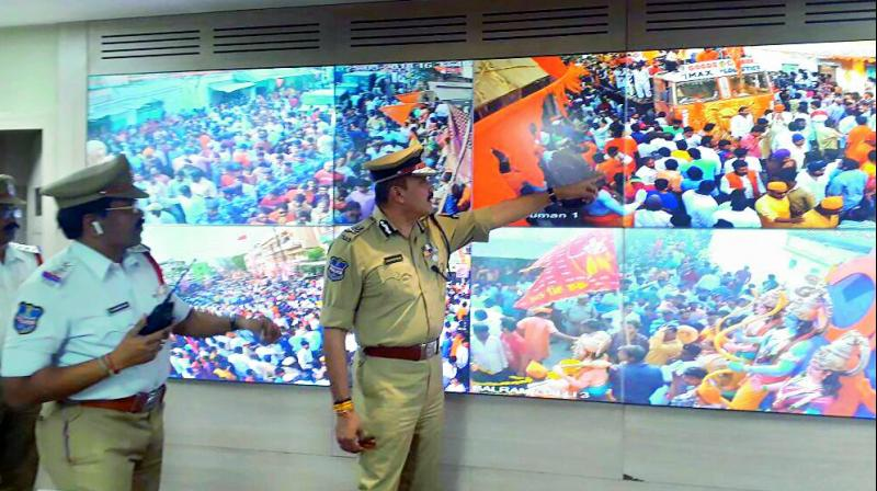 Police keep tab of CCTV footage of the Rama Navami procession taken out in the city on Sunday.
