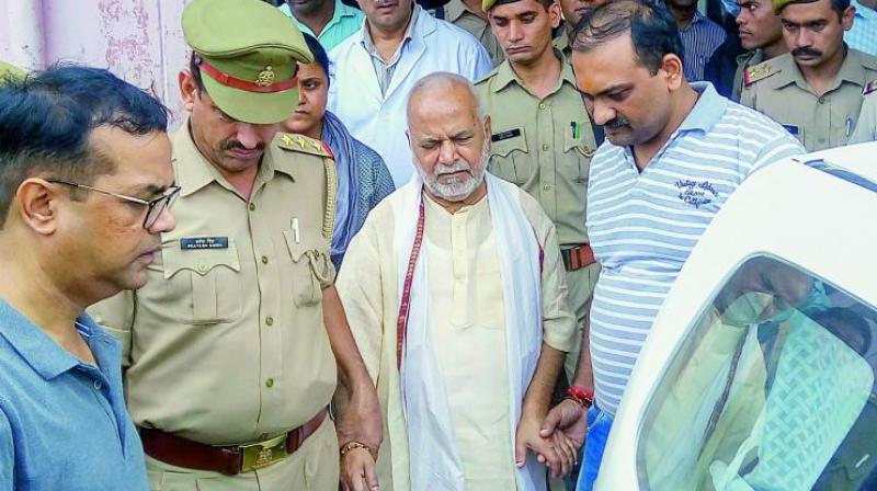 ources said the SIT also booked the woman on charges of causing disappearance of evidence. (Photo: PTI)