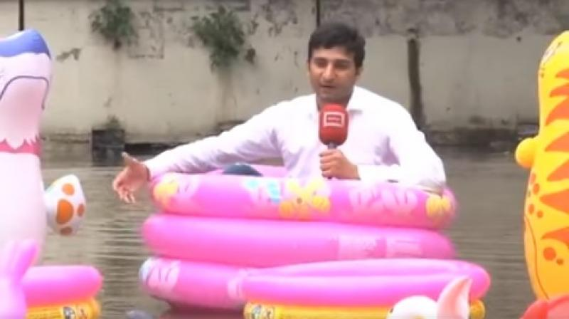 "He further said he is ""enjoying in water pool"" and recommended the locals to do the same ""as the water was not going to recede anytime soon."" (Photo: Dunya News/ ANI)"