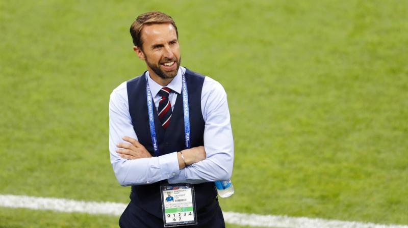 England head coach Gareth Southgate smiles as he walks on the pitch before the round of 16 match between Colombia and England at the 2018 soccer World Cup in the Spartak Stadium, in Moscow, Russia. (Photo: AP)