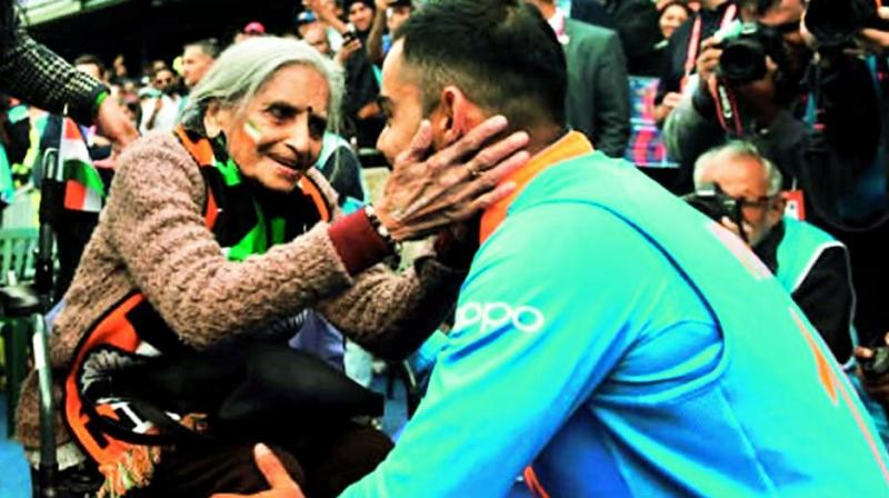 Virat Kohli, after the match went to meet and seek the blessings of Charulata Patel.