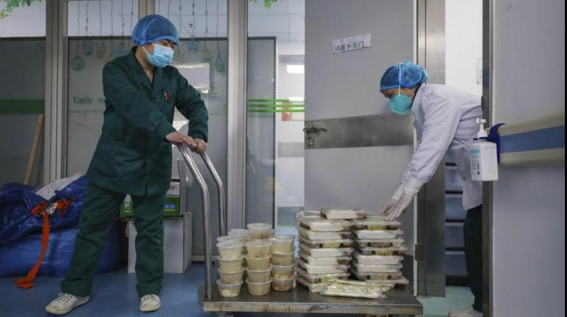 Covid-19 deaths hit 1,400 in China, new cases at 5,090