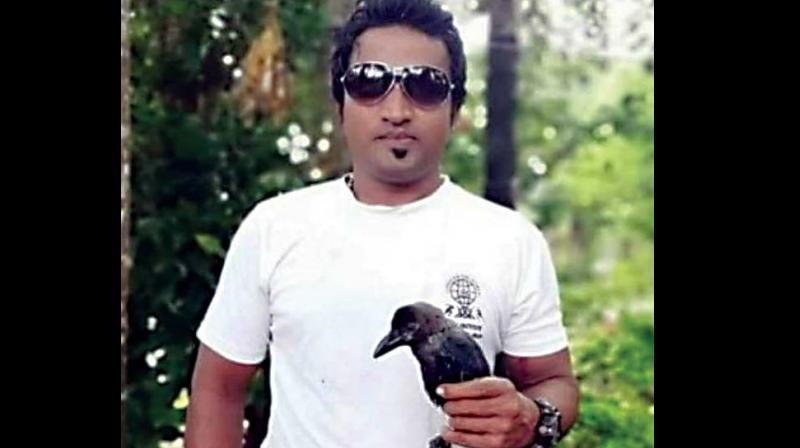 Prashanth with son's pet crow.