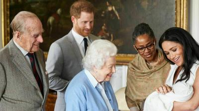 Pictured here are the Duke and Duchess of Sussex with their newborn Archie. The Queen, Prince Phillip and the Duchess's mom Doria Ragland can be seen fawning over the baby. (Photo: AP/Chris Allerton/Sussexroyal)