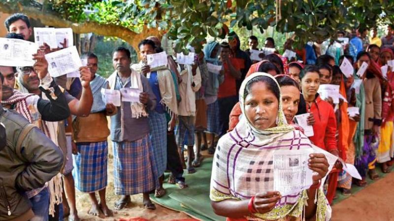 Voters wait in queues to cast their votes during the first phase of Assembly elections in Chhattisgarh at a polling station in Narayanpur. (Photo: PTI)