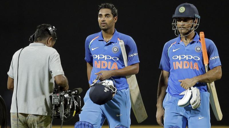 Bhuvneshwar Kumar and Mahendra SIngh Dhoni guided India to  three-wicket win. (Photo: AP)