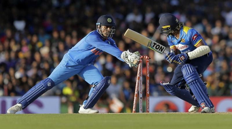 Dhoni, who made his debut in 2004 against Bangladesh, achieved the feat in his 301st ODI against Sri Lanka in Colombo. (Photo: AP)