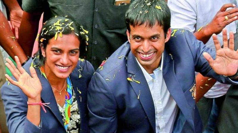 Gopichand (right) said that there is immense potential but a lot needs to be done in the system. (Photo:AP)