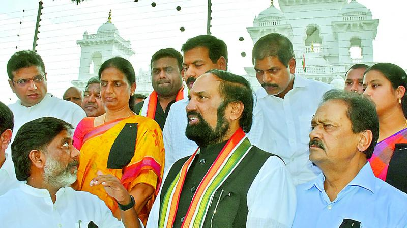 Congress MLAs stage protest wearing black badges outside the Assembly on Sunday, accusing the TRS of poaching MLAs ahead of MLC polls. (Photo: DC)