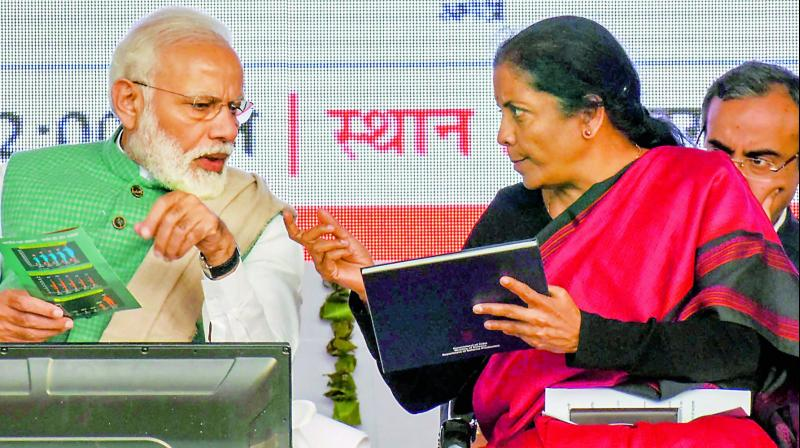 Prime Minister Narendra Modi with Union defence minister Nirmala Sitharaman  during a public rally to launch a Kalashnikov rifles manufacturing facility, in Amethi on Sunday (Photo: AP)
