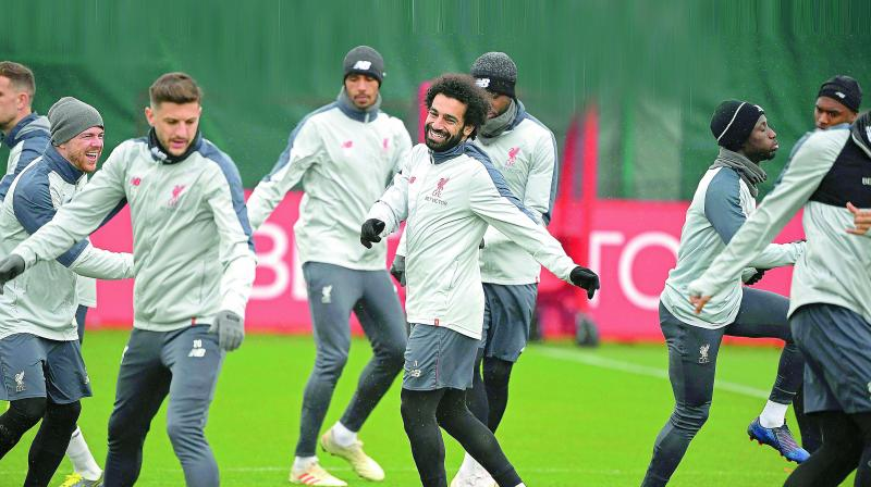 Liverpool players at a training session on Tuesday, the eve of their Champions League quarterfinal second leg match against FC Porto.(Photo: AFP)