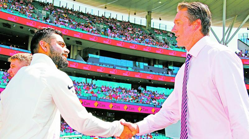 India captain Virat Kohli greets former Australian bowler Glenn McGrath. (Photo: AFP)