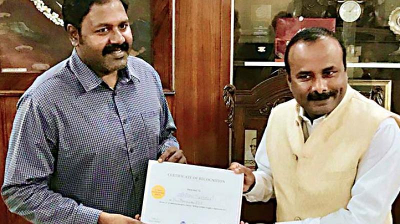 A file photo of Srinivas Alavilli, with former Mayor Sampath Raj
