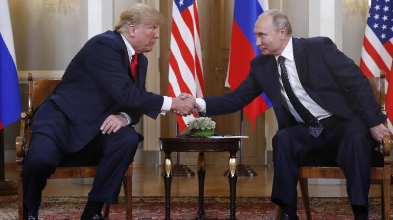 Trump reached out to shake Putin's hand before the media were ushered out. (Photo: AP)
