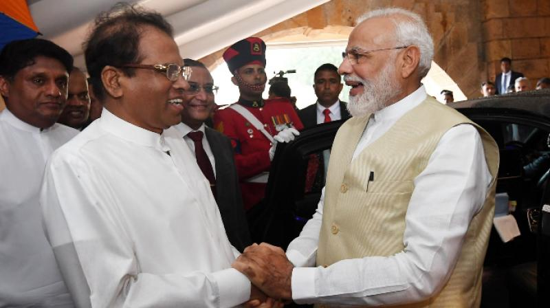 PM Narendra Modi with Sri Lankan President Maithripala Sirisena. (Photo: Twitter/Narendra Modi)