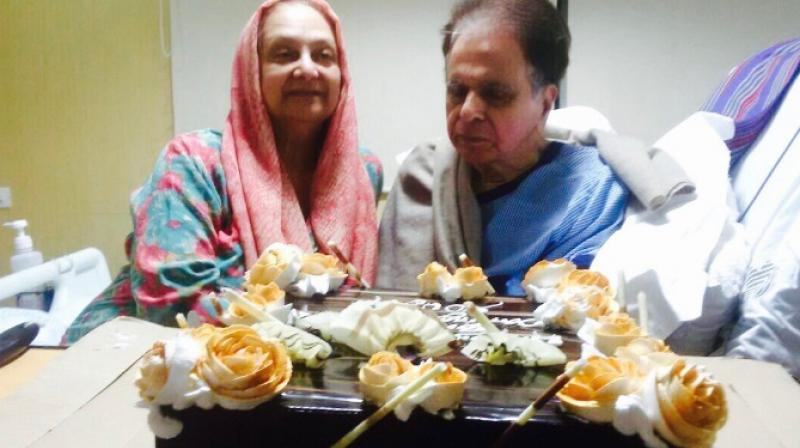 Dilip Kumar shared this picture, captioning it: Saira, helps me cut a cake...(Pic courtesy: Twitter/ TheDilipKumar).
